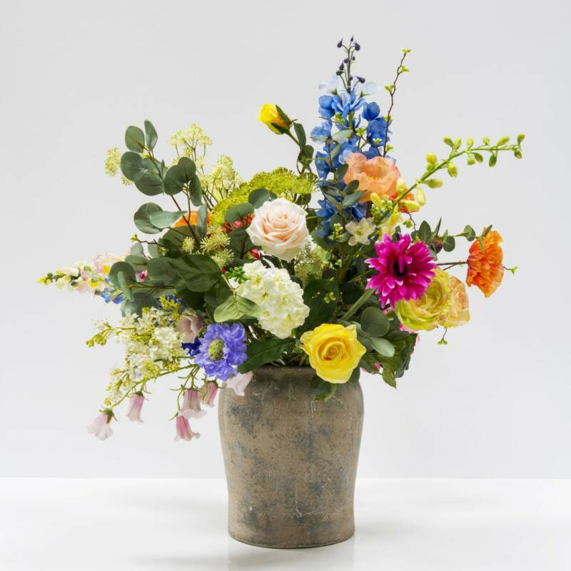Earthenware vase with flower arrangement