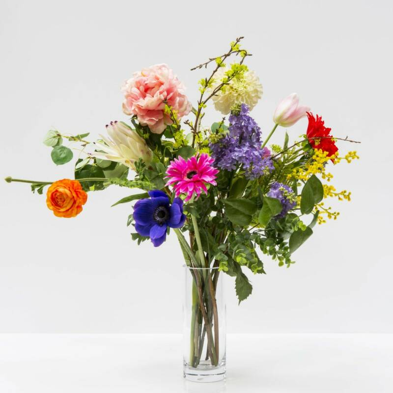 Cylindrical glass vase with flower arrangement